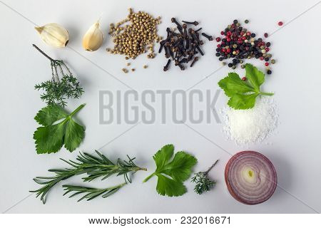 Various Spices And Herbs On White Background With Copy Space. Concept Is A Healthy Varied Diet.