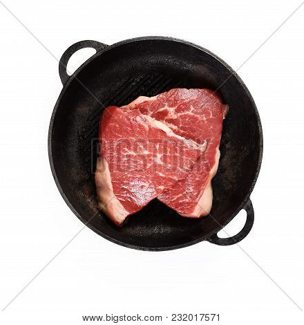 Fresh Raw Marble In A Frying Pan Over White Background