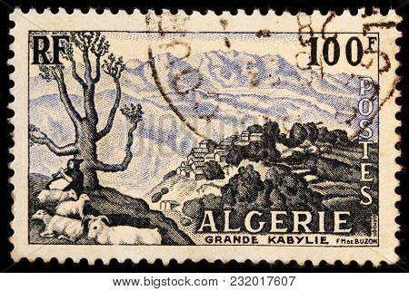 Luga, Russia - January 23, 2018: A Stamp Printed By Algeria Shows View Of Kabylie (kabylia) - Cultur