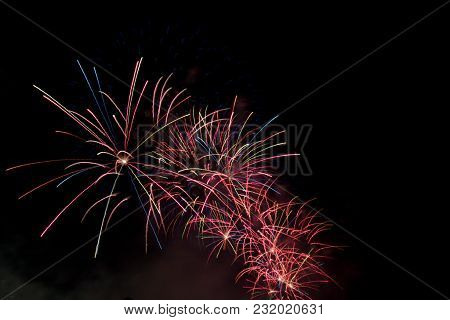 A Fire Works With A Dark Background