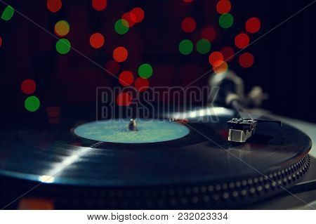 Turntable, Record-player Of Vinyl Disks Close-up, Against The Background Of Colored Lights