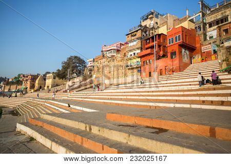 VARANASI, INDIA - MAR 19, 2018: Banks on the holy Ganges river in the early morning. According to legends, the city was founded by God Shiva about 5000 years ago.