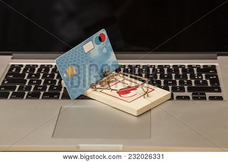 Concept Photo, Credit Card Placed In A Trap, The Risk Of Buying And Investing In The Network