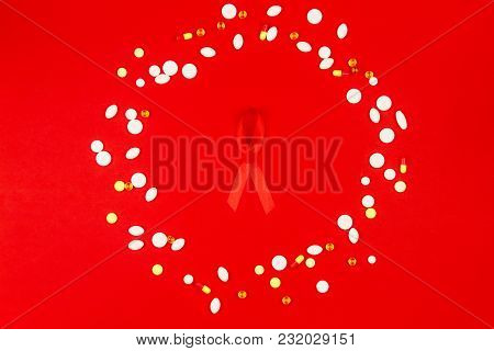 Red Tape As Symbol Of Aids / Hiv Illness With Medicine Drugs Isolated On Red Background