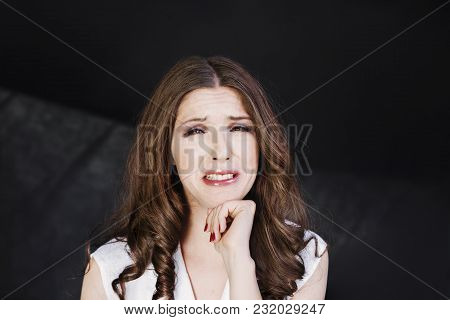 Woman With Uncombed Hair Make A Grimace In White Shirt Stand Studio Shoot On Dark Background