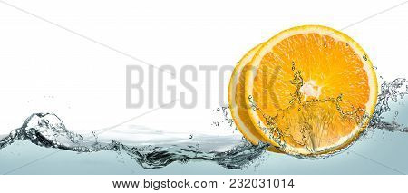 Lemon Slices In The Spray Of Water.