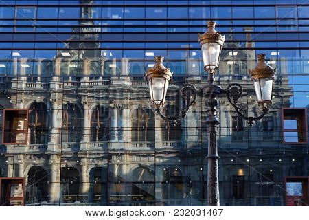 Lyon, France, March 19, 2018 : Reflection Of The Trade House Of Lyon In Glass Facade Of A Big Store.