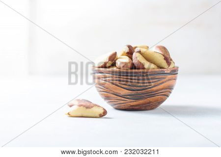 Wooden Bowl With Brazil Nuts On A Light Background. Healthy Food. Selective Focus