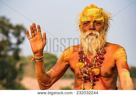 Jaipur, India - November 9, 2017: Portrait Of Unidentified Sadhu Man Sitting Outside. A Sadhu Also I