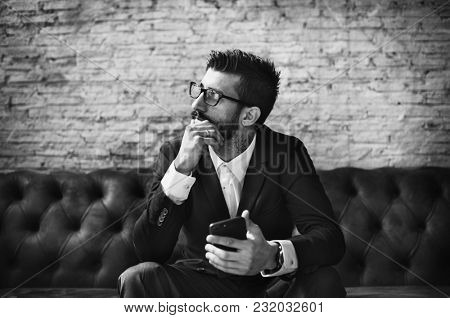 Classy man using mobile phone