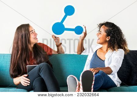 Young girls with share icon