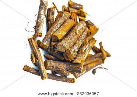 Close Up Of Ayurvedic Herb Liquorice Root,licorice Root, Mulethi Or Glycyrrhiza Glabra Root Isolated