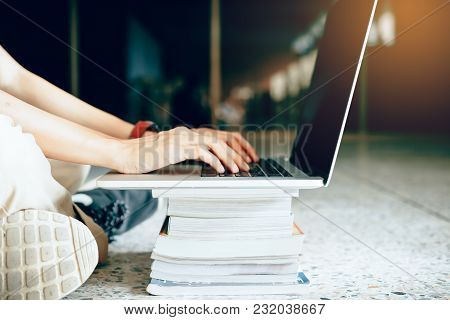 Woman Using Laptop In Library At University.