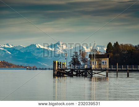 View Over Lake Constance Towards The Austrian Alps During Calm Day