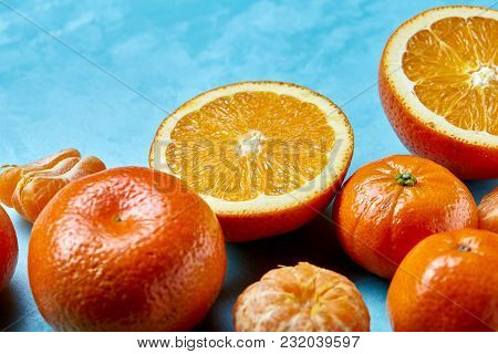 Variety Of Fresh Citrus For Making Juice Or Smoothie Over Blue Textured Background, Topview, Selecti