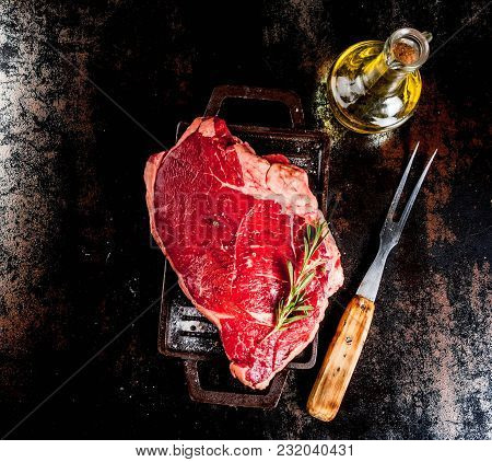 Fresh Raw Meat, Lamb Beef Marble Steak On A Grill Pan Board, With Ingredients For Cooking. On Dark R
