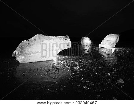 Natural Ice Blocks. Ice Floe Breaking Due To Strong Wind Against The Shore And Move. Freezing Winter