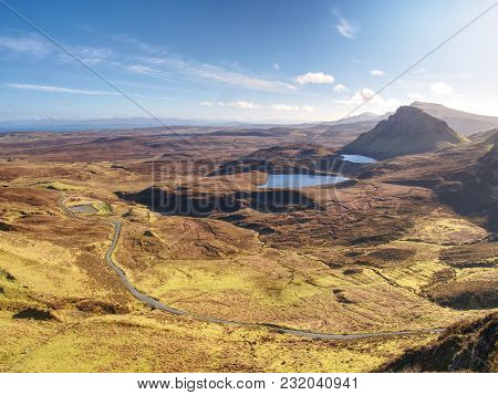 Breathtaking View From Quiraing Mountains Into Vallley. Sunny Winter Midday. Hilly Landscape Of Isle