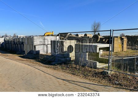 Construction Site With Pipe And Concrete For Building Houses Surrounded With Fencing