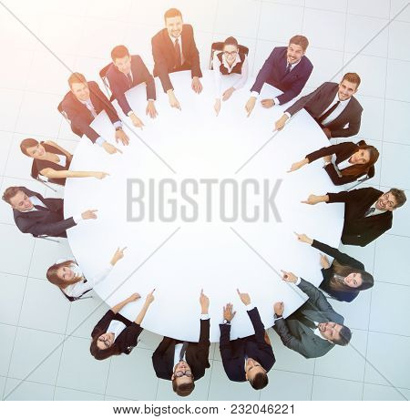 group of business people sitting at the round table. the busines