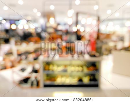 Blurred Shoes On Shelves In Shopping Center With Bokeh Light