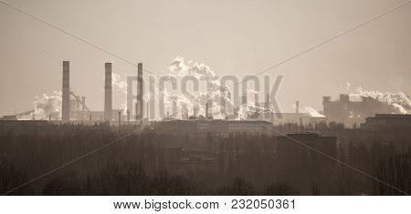 Smoke From The Pipes Of An Industrial Plant In The Morning .
