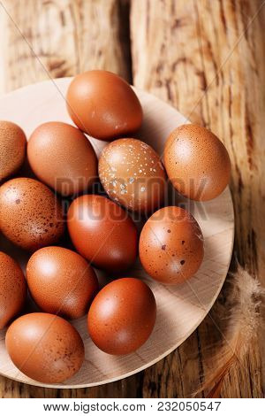 Easter Eggs In Plate On A Wooden Background