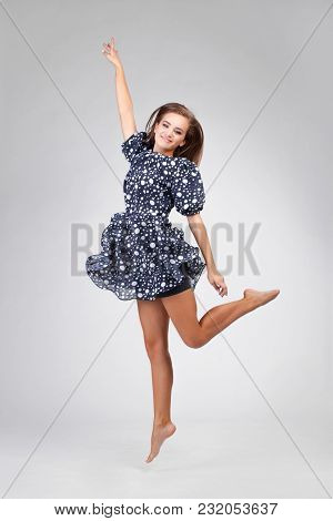 Beautiful Girl With Long Straight Hair Dancing, Jumping Up, Stretches Upwards, Raised Her Hand Up, I