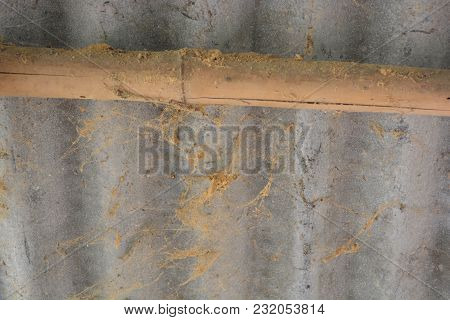 The Wall Is Deserted With Zinc Sheets And Bamboo. There Are Decay And Spider Webs.