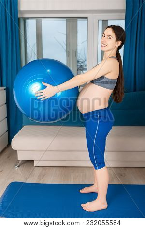 Happy Pregnant Woman Doing Exercises With Fit Ball At Home. Expectant Mother. Pregnancy, Gymnastics