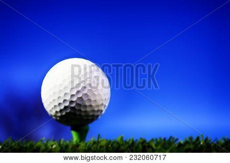 Golf Ball On Green Tee On Golf Course Sky Blue