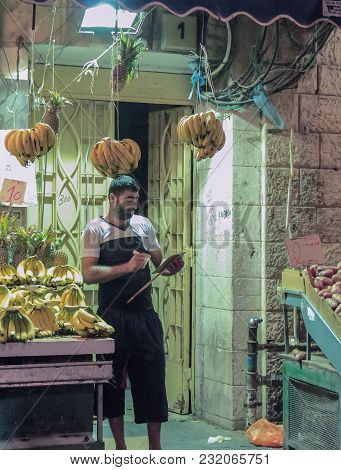 Jerusalem, Israel, September 10, 2015 :  The Seller Stands Near His Open Shop In The Mahane Yehuda M