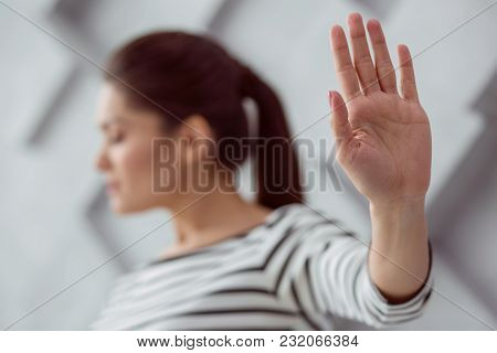 Female Hand. Selective Focus Of A Hand Of A Cheerless Nice Depressed Woman Being Shown To You