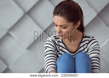 Bad Mood. Sad Depressed Cheerless Woman Sitting And Closing Her Eyes While Being In The Bad Mood