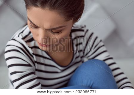 Personal Problem. Portrait Of A Cheerless Depressed Sad Woman Sitting On The Floor And Closing Her E