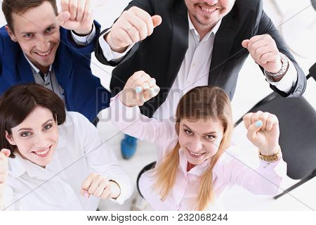 Group Of Joyful Happy People In Suits Celebrate Win With Arms Up. White Collar Leadership Sale Resul