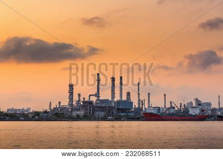 Oil And Gas Refinery Plant At Sunrise