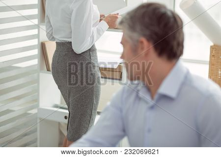 Sexual Interest. Attractive Nice Young Woman Standing In The Office And Working While Being Looking