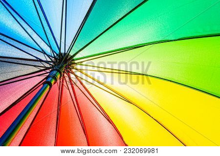 Bottom View Of Rainbow Umbrella Texture Background.