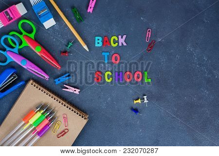 School Supplies On Blue Background. Wooden Letters? Back To School Concept
