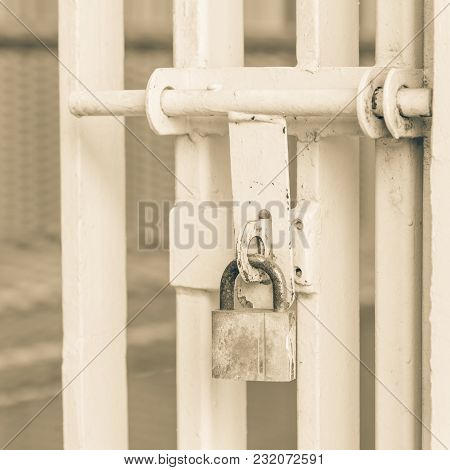 Close-up Metal Gate With Rusty Padlock Latch Security, Protection Concept