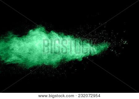 Green Color Powder Explosion Cloud Isolated On Black Background.
