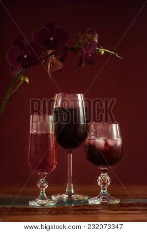 Alcohol Drinks (red Wine, Sparkling Wine) On Dark Solid Red Background