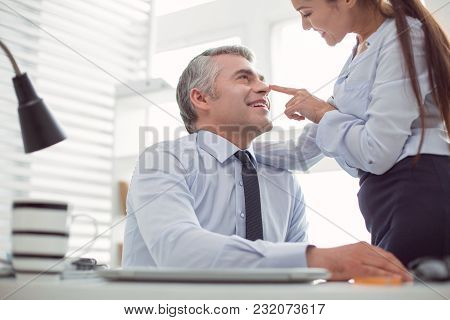 Flirting In The Office. Happy Nice Handsome Man Looking At His Colleague And Smiling While Flirting