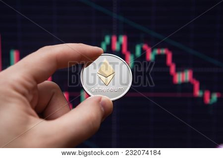 Crypto Currency Etherium. Ethereum Coin On Exchange Charts. E-currency Etherium On The Background Of