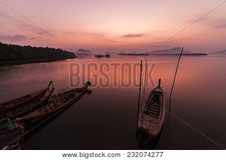 Longtail Boat With Coastal Fishing Village,beautiful Scenery View In Morning Sunrise Over Sea And Mo