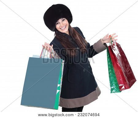 Young Woman In Winter Clothes With Shopping Bags .isolated On White Background