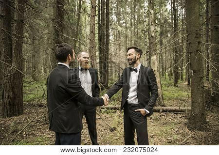 Handshake Business Partners At An Informal Meeting