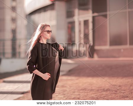 Modern Business Woman On A City Background. Photo Has Empty Space For Your Text