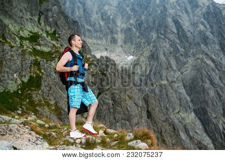 Young Man Enjoying Beautiful View Of Mountains.